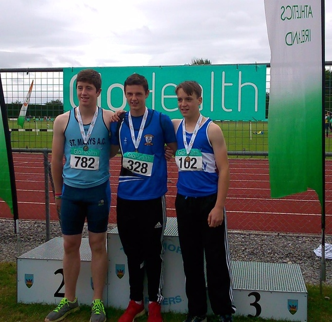 Gabriel Bell (in the centre) at Irish Juvenile Championships (Tullamore, July 2015)